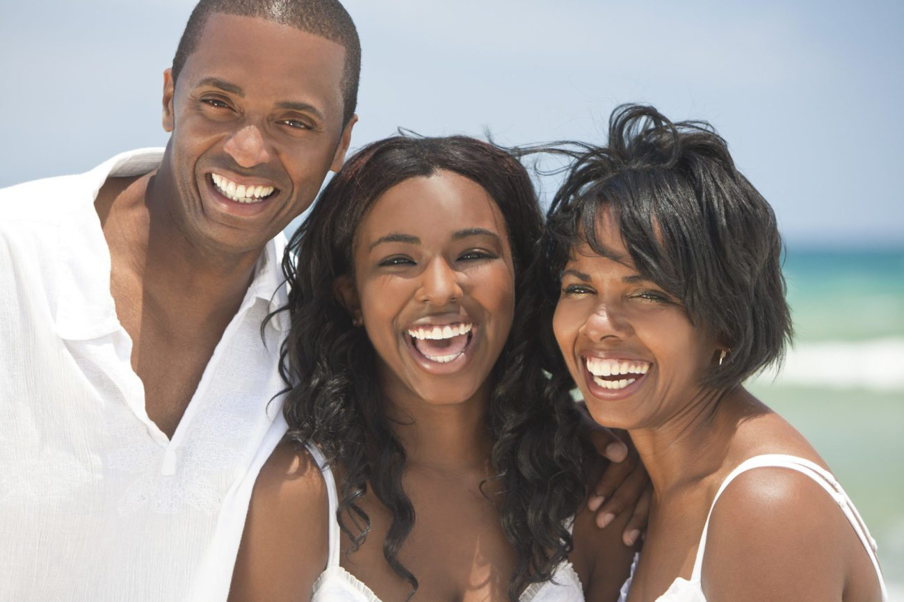 Happy Family On Beach cosmetic dental smile makeovers plantation fl